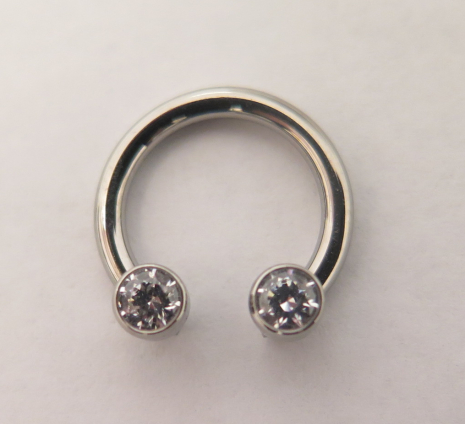 Ti ring 1.6x9.5mm med front facing holes, 2 Ti Gem 16g 3mm CZ